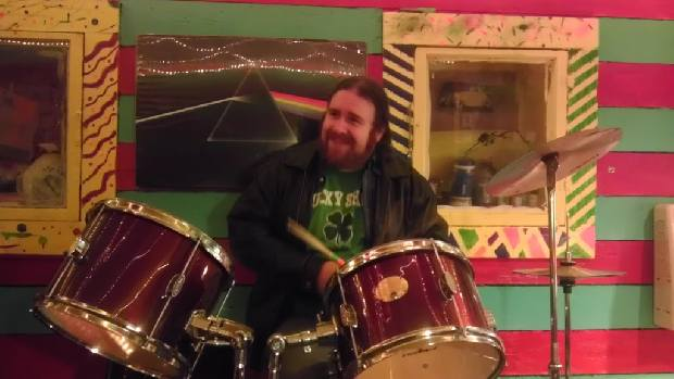 """A pic of Rosco """"Carrico"""" Crooke playing drums inside his studio,""""The creative workshop"""""""