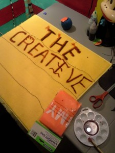 "This is a picture of creating ""The Creative Workshop"" sign."