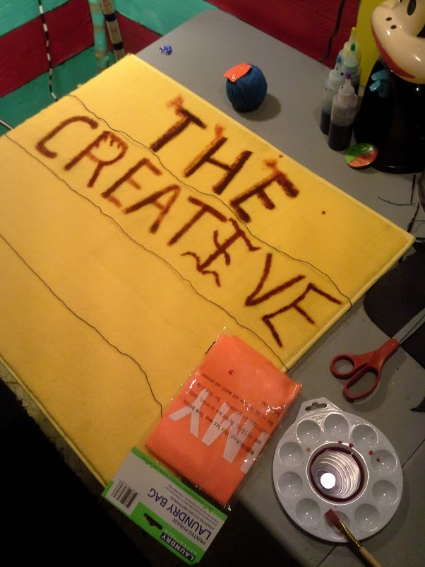 """This is a picture of creating """"The Creative Workshop"""" sign."""